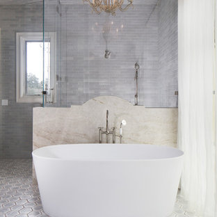 Inspiration for a large transitional kids bathroom in Austin with a freestanding tub, a corner shower, ceramic tile, grey walls, terra-cotta floors, grey floor and a hinged shower door.
