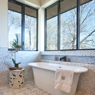 Example of a transitional mosaic tile freestanding bathtub design in Austin