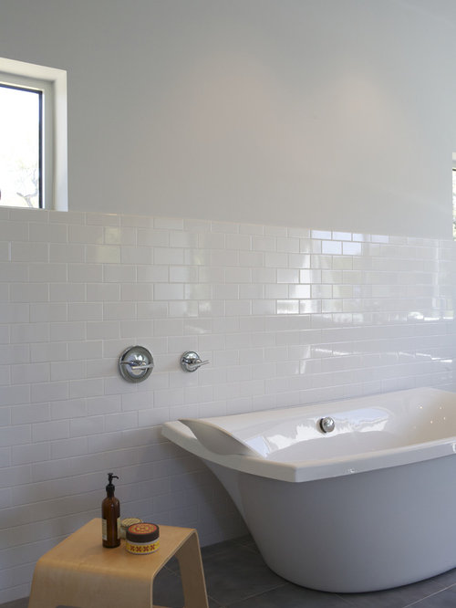 Modern subway tile gray floor freestanding bathtub idea in Austin. Gray Floor Tile   Houzz