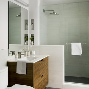 Bathroom - mid-sized contemporary 3/4 gray tile bathroom idea in Boston with an undermount sink, flat-panel cabinets, medium tone wood cabinets, engineered quartz countertops and white walls