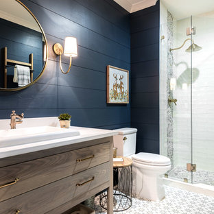Alcove shower - farmhouse 3/4 multicolored tile and white tile multicolored floor alcove shower idea in Atlanta with furniture-like cabinets, dark wood cabinets, a two-piece toilet, blue walls, a drop-in sink and a hinged shower door