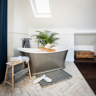 Mid-sized transitional master bathroom in Berkshire with a freestanding tub, white tile, white walls, porcelain floors and beige floor.