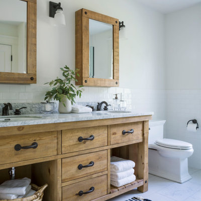 Example of a country master multicolored floor bathroom design in Burlington with flat-panel cabinets, medium tone wood cabinets and gray countertops