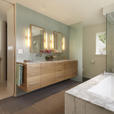 Bathroom - contemporary gray tile bathroom idea in Minneapolis with an undermount sink, flat-panel cabinets, an undermount tub and light wood cabinets