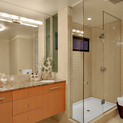 Inspiration for a contemporary beige tile corner shower remodel in Seattle