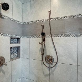 Idées déco pour une petit salle de bain principale craftsman avec un placard à porte shaker, des portes de placard en bois brun, un carrelage gris, carrelage en mosaïque, un mur bleu, un sol en bois brun, un lavabo encastré, un plan de toilette en surface solide, un sol beige et une cabine de douche à porte battante.