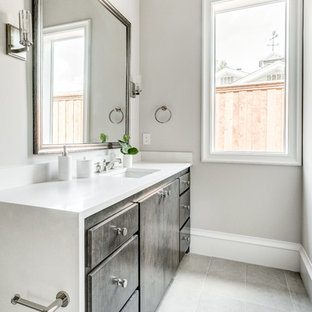 Design ideas for a large mediterranean ensuite bathroom in Dallas with shaker cabinets, white cabinets, a walk-in shower, a two-piece toilet, grey tiles, porcelain tiles, white walls, porcelain flooring, a submerged sink, engineered stone worktops, grey floors, a hinged door and white worktops.