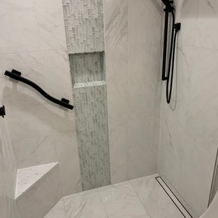 Example of a small trendy 3/4 white tile and porcelain tile porcelain floor and white floor bathroom design in Orlando with flat-panel cabinets, gray cabinets, a one-piece toilet, gray walls, a vessel sink, quartz countertops and white countertops