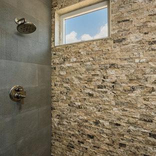 На фото: большая главная ванная комната в стиле рустика с искусственно-состаренными фасадами, японской ванной, душем без бортиков, бежевой плиткой, каменной плиткой, паркетным полом среднего тона, врезной раковиной, столешницей из гранита, коричневым полом, душем с распашными дверями и серой столешницей с