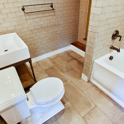 Inspiration for a large contemporary kids' beige tile and subway tile porcelain tile bathroom remodel in Philadelphia with an undermount sink, a one-piece toilet, yellow walls and furniture-like cabinets