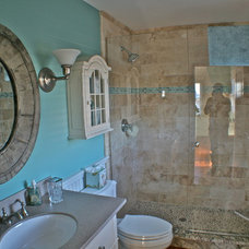 Beach Style Bathroom by Tyler and Traywick Building Company