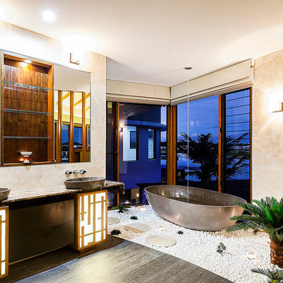 Freestanding bathtub - contemporary freestanding bathtub idea in Los Angeles with a vessel sink