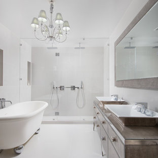 Example of a mid-sized minimalist master white tile and ceramic tile ceramic tile and beige floor bathroom design in New York with furniture-like cabinets, medium tone wood cabinets, a one-piece toilet, white walls, a vessel sink, glass countertops, a hinged shower door and turquoise countertops