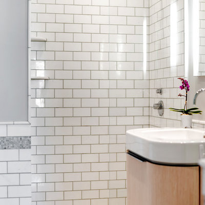 Alcove shower - small contemporary master white tile and subway tile mosaic tile floor alcove shower idea in New York with furniture-like cabinets, light wood cabinets, green walls and an integrated sink
