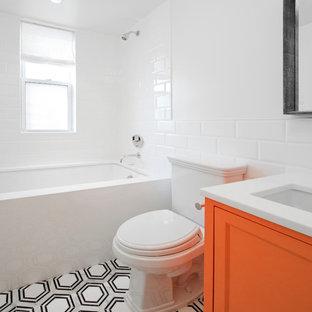 На фото: маленькая ванная комната в современном стиле с фасадами с утопленной филенкой, оранжевыми фасадами, ванной в нише, душем в нише, раздельным унитазом, белой плиткой, керамической плиткой, белыми стенами, мраморным полом, душевой кабиной, врезной раковиной, столешницей из кварцита, серым полом и шторкой для ванной с