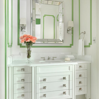 Example of a mid-sized classic mosaic tile floor and white floor bathroom design in St Louis with furniture-like cabinets, white cabinets, green walls, an undermount sink, marble countertops and white countertops