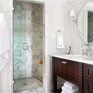 Inspiration for a timeless white tile alcove shower remodel in Denver with an undermount sink, dark wood cabinets and shaker cabinets
