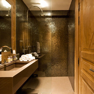 Photo of a medium sized contemporary shower room in London with a submerged sink, a built-in shower, metal tiles and black tiles.