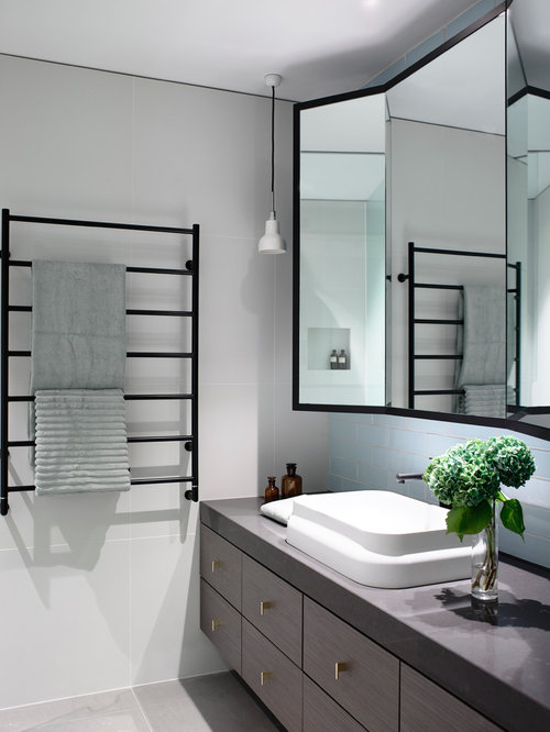 example of a trendy gray tile bathroom design in melbourne with a vessel sink flat