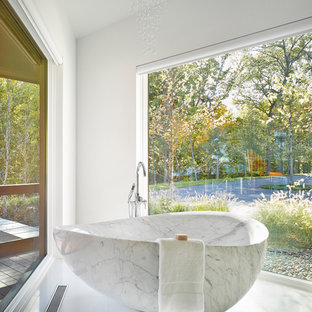 Inspiration for a huge contemporary master white tile white floor bathroom remodel in Burlington with flat-panel cabinets, white walls, an undermount sink, medium tone wood cabinets, a two-piece toilet, marble countertops and a hinged shower door