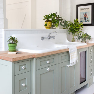Inspiration for a small rural family bathroom in Raleigh with shaker cabinets, grey cabinets, a corner shower, white walls, a built-in sink, wooden worktops, white floors, a hinged door and brown worktops.