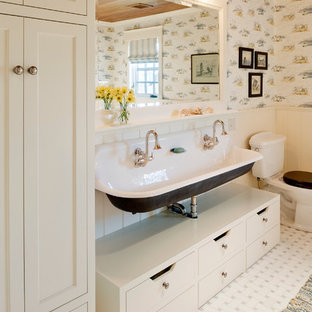 This is an example of a medium sized coastal family bathroom in Providence with a trough sink, flat-panel cabinets, white cabinets, a freestanding bath, a two-piece toilet, multi-coloured walls and ceramic flooring.