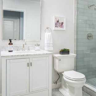 Small trendy master mosaic tile and gray tile marble floor and gray floor corner shower photo in Boston with shaker cabinets, white cabinets, a one-piece toilet, white walls, an undermount sink, marble countertops, a hinged shower door and gray countertops