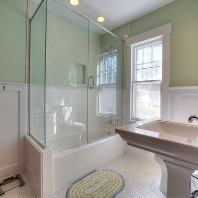 Inspiration for a mid-sized craftsman green tile and ceramic tile mosaic tile floor alcove bathtub remodel in Seattle with a pedestal sink and green walls