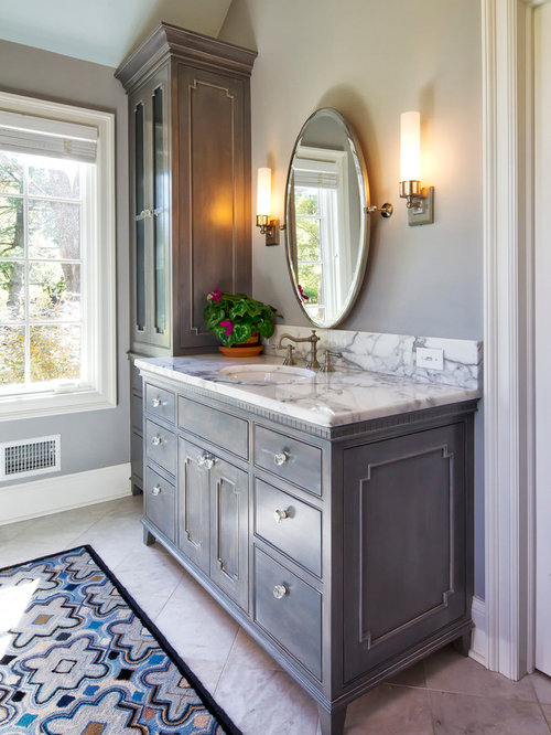 example of a classic bathroom design in new york with marble countertops and gray cabinets