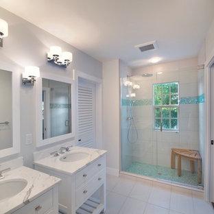 Alcove shower - traditional alcove shower idea in Miami with white cabinets