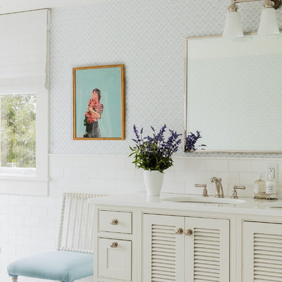 Elegant white tile bathroom photo in San Francisco with louvered cabinets, white cabinets, blue walls and an undermount sink
