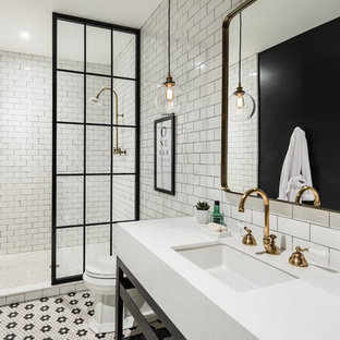 Mid-sized transitional master black and white tile and subway tile mosaic tile floor doorless shower photo in Phoenix with open cabinets, black cabinets, a two-piece toilet, black walls, an undermount sink and quartz countertops