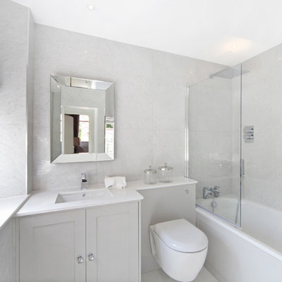 Small transitional master marble tile and gray tile bathroom photo in London with gray cabinets, a wall-mount toilet, gray walls, white countertops, shaker cabinets and an undermount sink