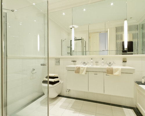 Example Of A Trendy Bathroom Design In London With Wall Mount Toilet