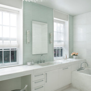 Inspiration for a transitional master blue tile and glass tile bathroom remodel in New York with an undermount sink, flat-panel cabinets, white cabinets and an undermount tub
