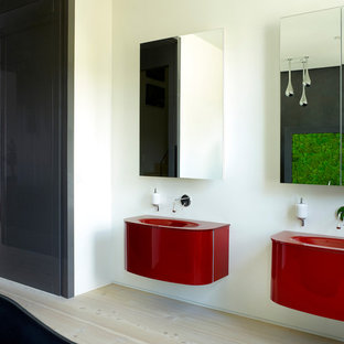 Design ideas for a large contemporary ensuite bathroom in London with red cabinets, white walls, light hardwood flooring, solid surface worktops, beige floors, red worktops and an integrated sink.