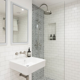 Inspiration for a small contemporary shower room in London with a walk-in shower, white tiles, white walls, cement flooring, a wall-mounted sink, a hinged door, metro tiles and beige floors.