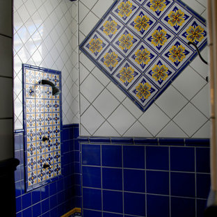 Inspiration for a large mediterranean master bathroom in Sacramento with raised-panel cabinets, dark wood cabinets, an undermount tub, blue tile, ceramic tile, beige walls, terra-cotta floors, an undermount sink, tile benchtops, red floor and orange benchtops.