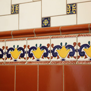Bathroom - mid-sized mediterranean 3/4 red tile and ceramic tile bathroom idea in Sacramento with beige walls and a pedestal sink