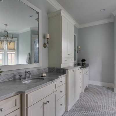 Example of a large classic master gray tile and mosaic tile mosaic tile floor bathroom design in Nashville with an undermount sink, white cabinets, marble countertops, green walls and recessed-panel cabinets
