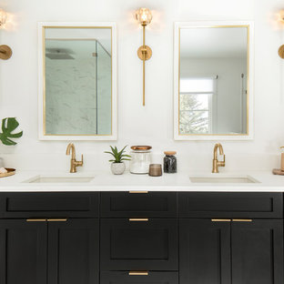 Bathroom - scandinavian bathroom idea in Denver with shaker cabinets, black cabinets, white walls, an undermount sink and white countertops