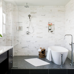 Bathroom - mid-sized contemporary master white tile and marble tile porcelain floor and black floor bathroom idea in Baltimore with flat-panel cabinets, white walls, an undermount sink, marble countertops, white countertops and black cabinets