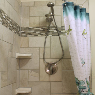 Small trendy master porcelain tile porcelain floor corner shower photo in Philadelphia with an integrated sink, raised-panel cabinets, solid surface countertops, a two-piece toilet and gray walls