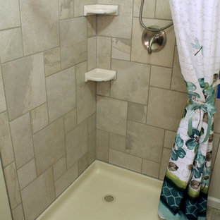Example of a small trendy master porcelain tile porcelain floor corner shower design in Philadelphia with an integrated sink, raised-panel cabinets, solid surface countertops, a two-piece toilet and gray walls