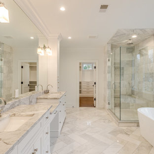Transitional master gray tile and metal tile marble floor and gray floor bathroom photo in Detroit with shaker cabinets, white cabinets, white walls, an undermount sink, marble countertops, a hinged shower door and gray countertops