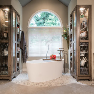 Mountain style pebble tile floor bathroom photo in St Louis with gray walls and a vessel sink
