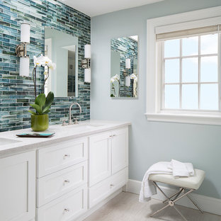 Transitional master white tile and porcelain tile porcelain floor bathroom photo in Boston with an undermount sink, shaker cabinets, white cabinets, terrazzo countertops and blue walls