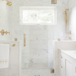 Small transitional master white tile and stone tile mosaic tile floor and white floor alcove shower photo in Boston with shaker cabinets, a wall-mount toilet, white walls, an undermount sink, marble countertops, white cabinets and a hinged shower door