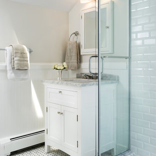 Inspiration for a timeless mosaic tile and black and white tile bathroom remodel in DC Metro with marble countertops