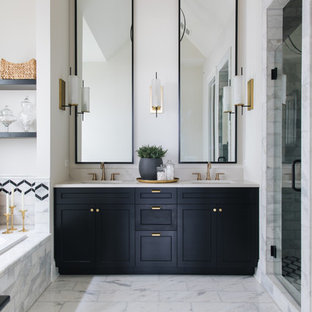 Design ideas for a country bathroom in Chicago with recessed-panel cabinets, black cabinets, a drop-in tub, an alcove shower, white tile, white walls, an undermount sink, white floor, a hinged shower door and white benchtops.